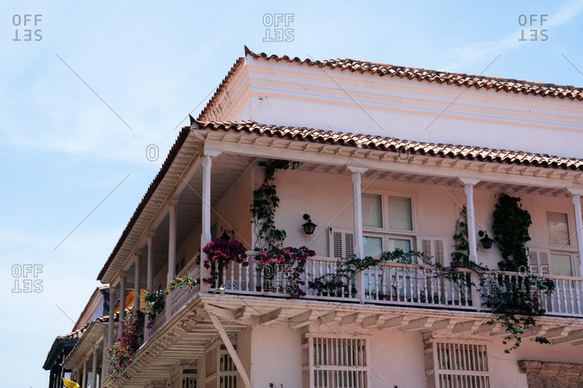 Lower angle view of rustic second story balcony on historical home