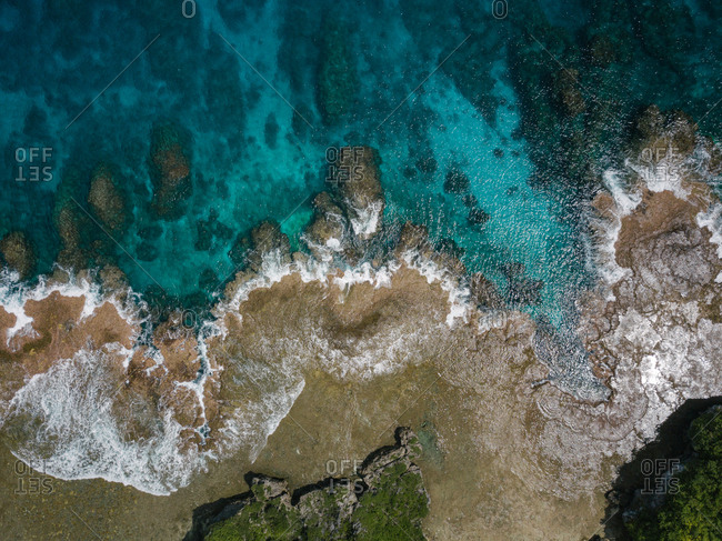Overhead view of shallow tide on sunny beach