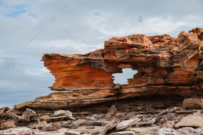 Natural rock formation under stormy clouds