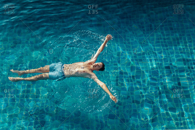 High angle view of man swimming in pool at resort