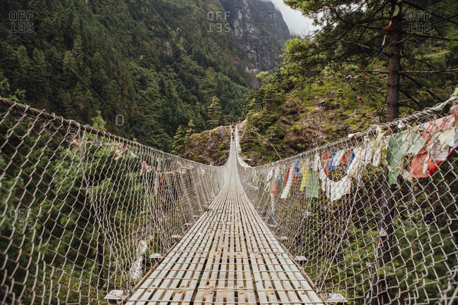 Diminishing perspective of footbridge amidst mountains at Sagarmatha National Park