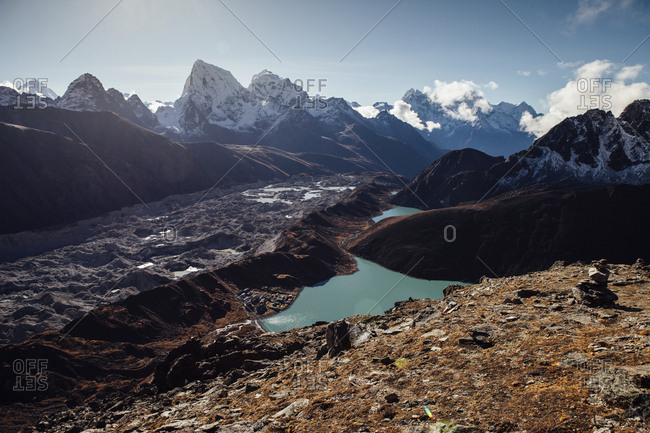 High angle view of lake amidst mountains against blue sky at Sagarmatha National Park