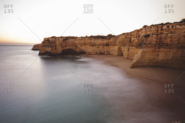 High angle view of sea by cliff against clear sky