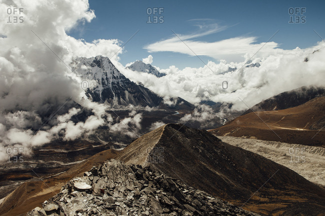 Scenic view of mountains against cloudy sky at Sagarmatha National Park during sunny day