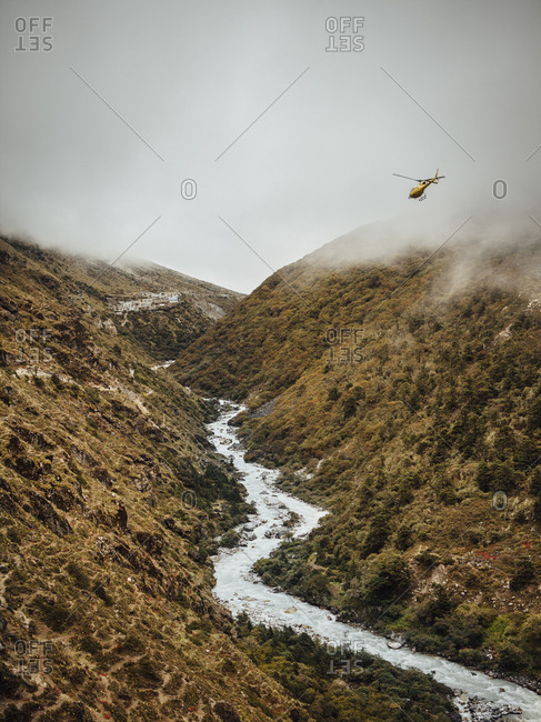 Scenic view of river amidst mountains against cloudy sky at Sagarmatha National Park