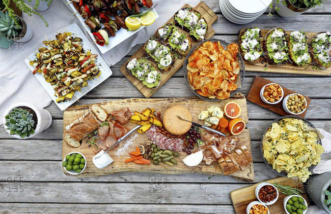 High angle view of various food served on wooden table
