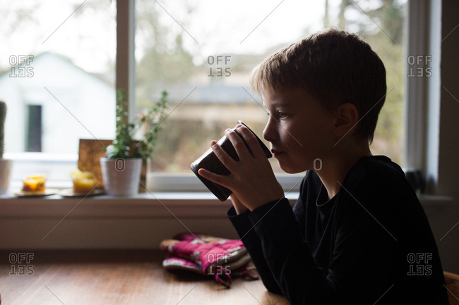 Boy drinking cup of hot cocoa