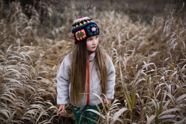 Portrait of a blonde girl walking in a field