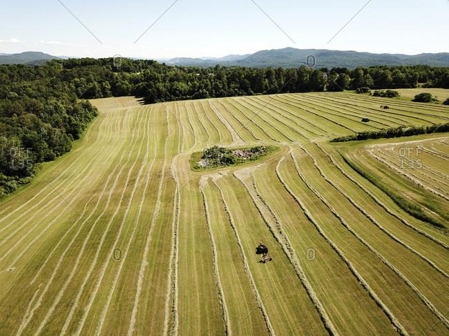 Farmer haying a field in Brandon, Vermont