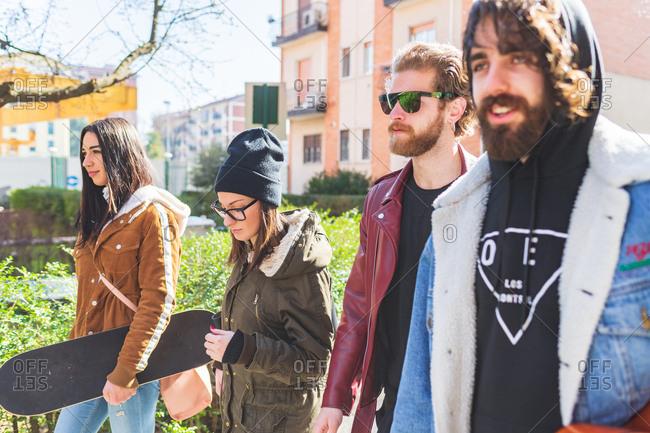 Four friends walking outdoors