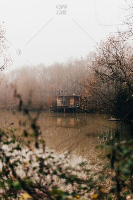 Woman sitting at house at river