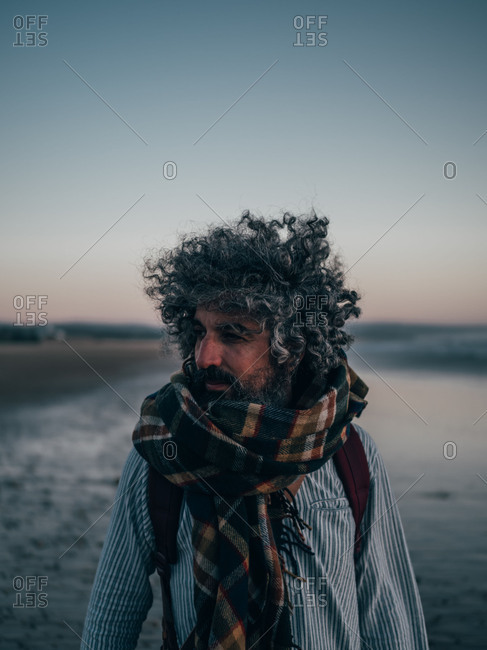 Adult man standing at the ocean
