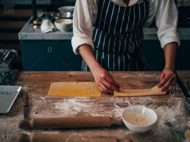 Crop cook making pasta