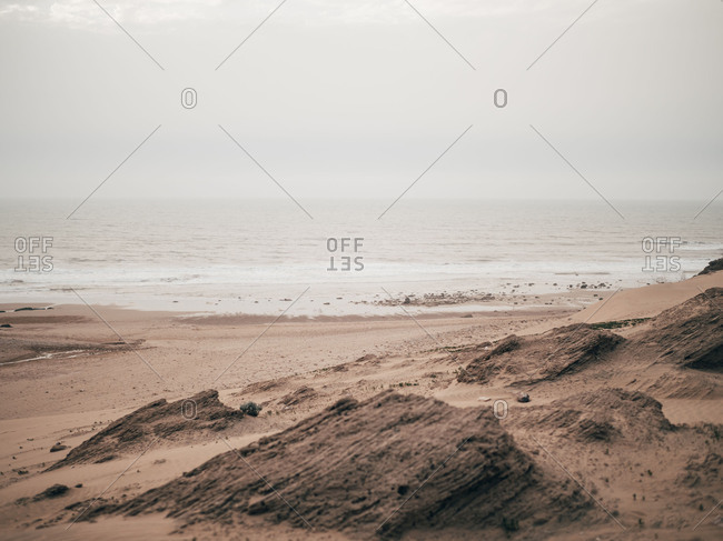 Calm ocean in cloudy day