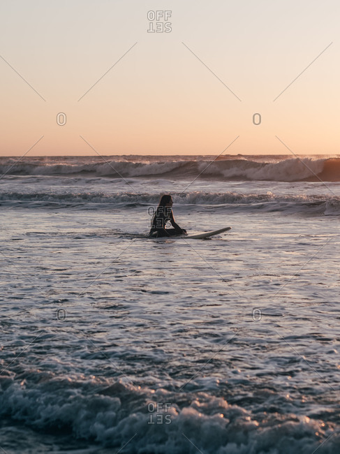 Surfer with board on coast