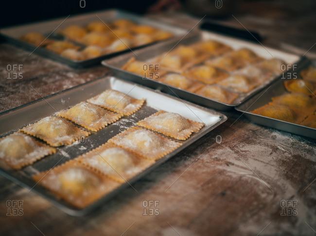 Prepared ravioli in pans