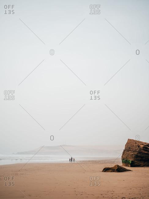 Travelers on calm coast
