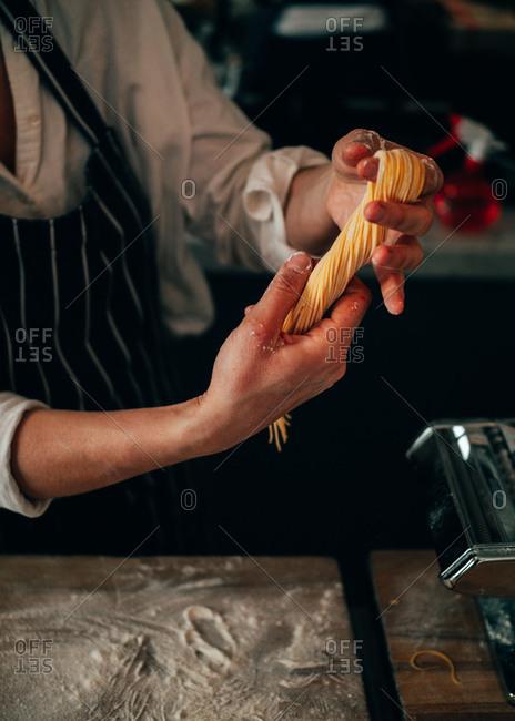 Crop cook making spaghetti