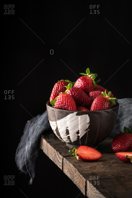 Ceramic bowl full of ripe strawberry