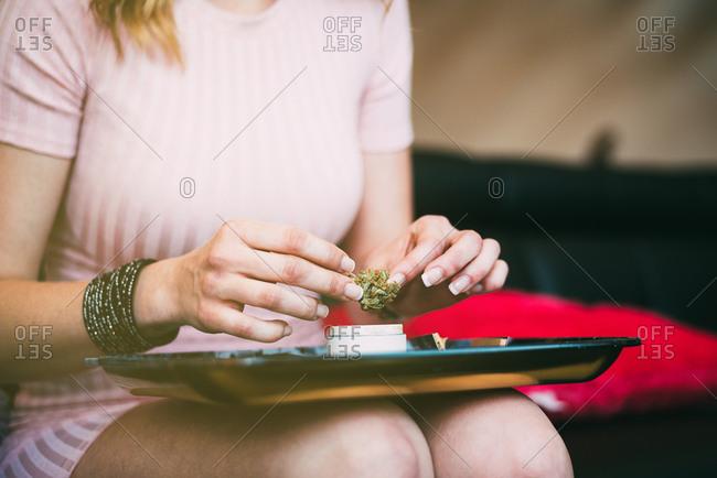 Woman preparing marijuana joint