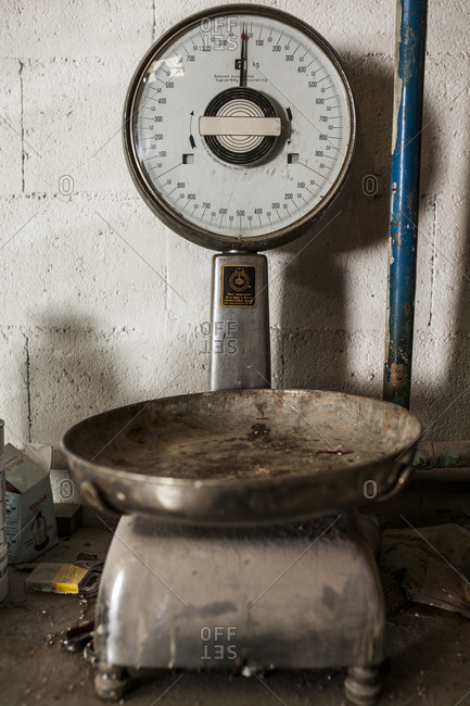 Crop view of older weighing machine standing in metal casting factory