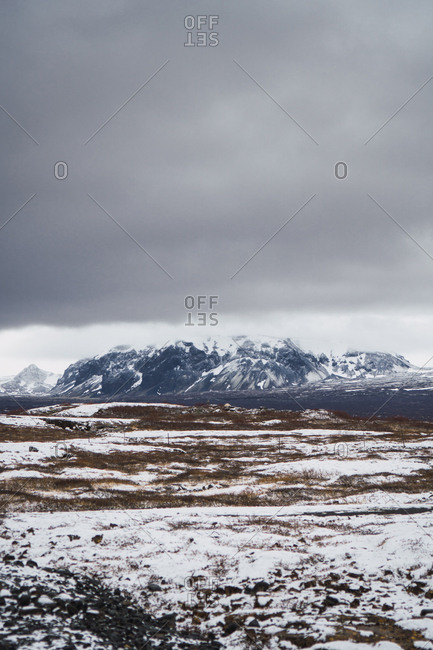 Tranquil snowy valley with mountains