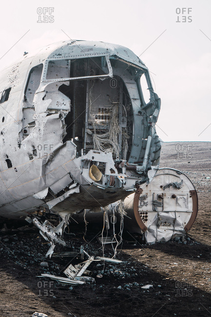 Ruins of aircraft after crash lying on ground in empty cold valley of Iceland.