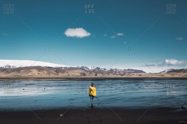 Woman standing next mountain landscape