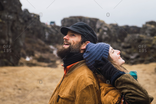 Couple in cold rocky gorge