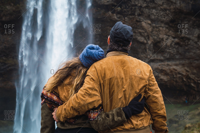 Couple posing near waterfall