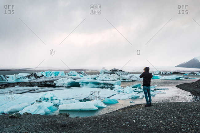 Man standing on cold sea