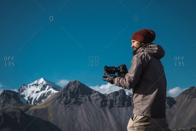 Cheerful photographer in outwear
