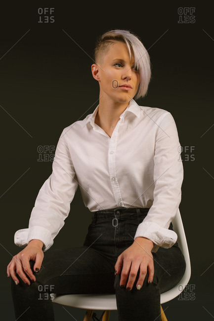 Portrait of a young woman with white shirt and short hair shot in studio