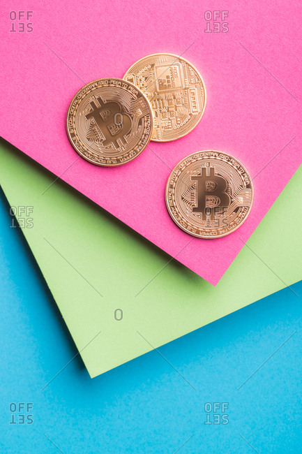 Bitcoins on colorful background