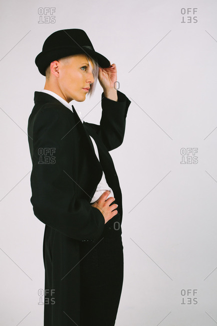 Portrait of a young woman with dark tailcoat shot in studio