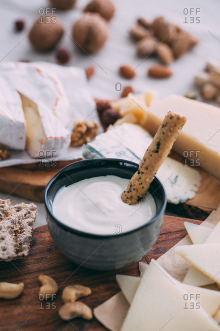 Cheese board with nuts, grapes and bread