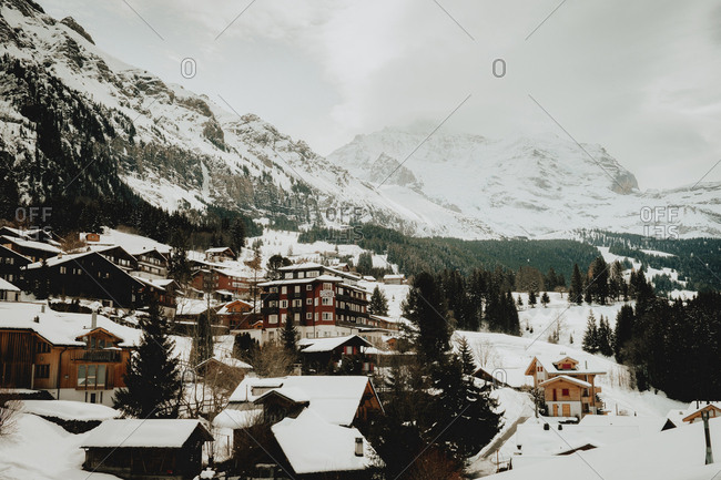 July 3, 2018: View to village houses covered with white snow in the hillside in winter day.