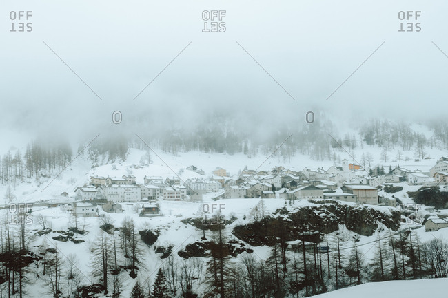 View to the village covered with snow in winter nature.