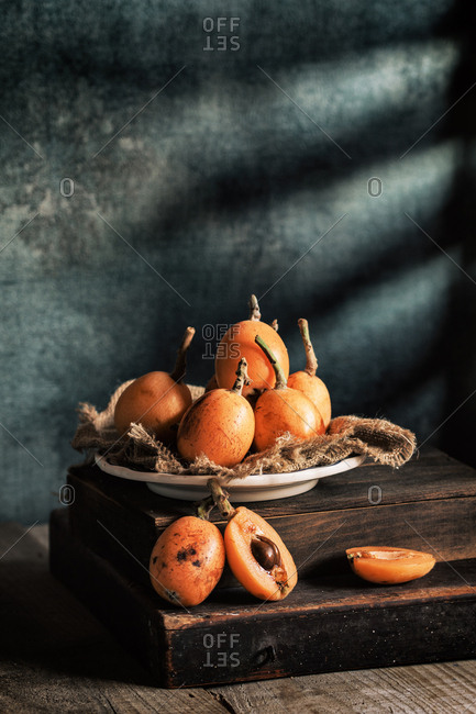 Fresh loquat served in plate with blue background