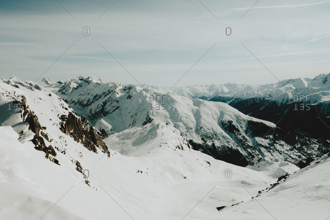 From above view to snowy white mountains in winter day.