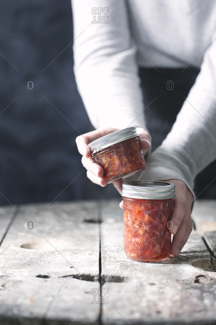 Hands with jars of jam