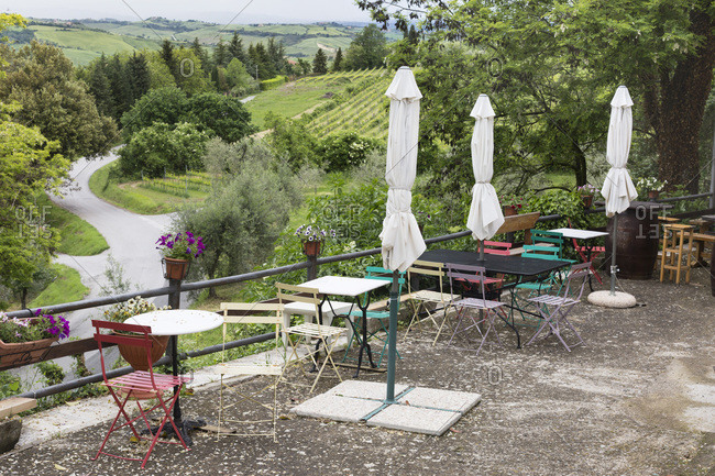 May 15, 2018: Cute cafe overlooking road and fields, Montepulciano, Tuscany, Italy