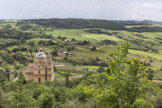May 15, 2018: San Biagio church with surrounding fields ands villas, Montepulciano, Tuscany, Italy