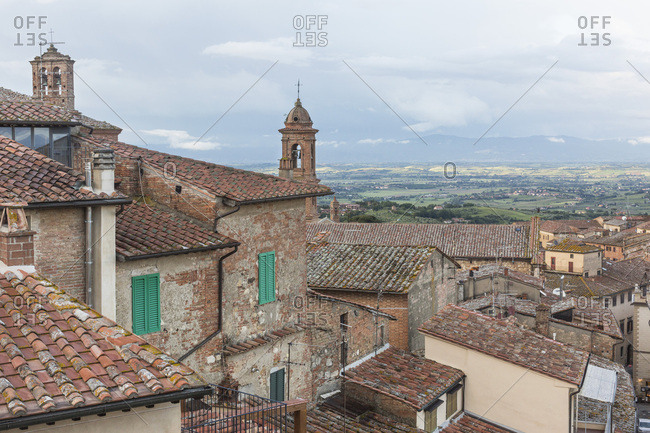 May 14, 2018: Bucolic view of rooftops and countryside in Montepulciano, Tuscany, Italy