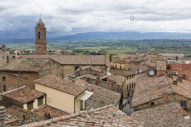May 15, 2018: Bucolic view of rooftops and countryside in Montepulciano, Tuscany, Italy
