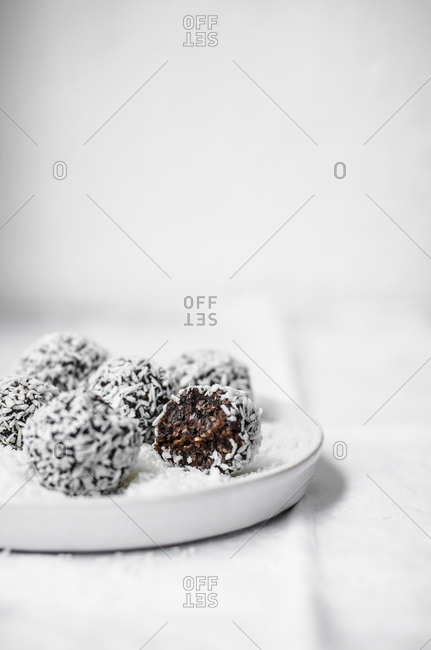 Chocolate coconut energy balls rolled in coconut.