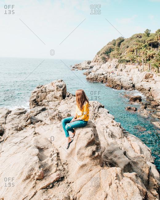 Girl enjoying the oceanside views in Catalonia Spain