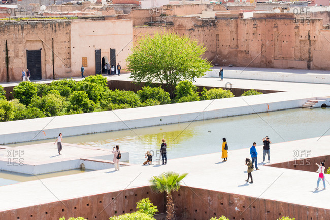 December 1, 2014: Tourists at The El Badi Palace in Marrakech Morocco