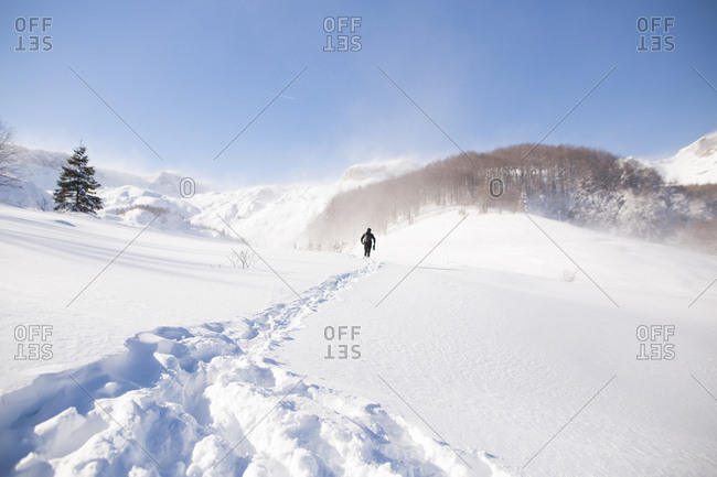 Man walking trough snowstorm