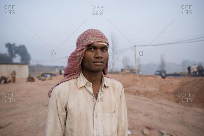 Kathmandu, Nepal - February 20, 2015: Portrait of a man standing alone in worksite